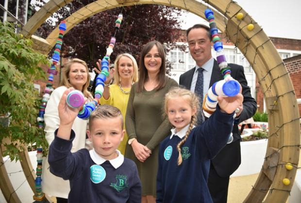 L-R (back row) Sharon O'Connor, Chair, Education Authority; Catherine Roulston, Principal, Blythefield PS; Linsey Farrell, Director of the Urban Villages Initiative, Mark Browne, Deputy Secretary TEO, Blythefield PS pupils, Torre Brown and Keri Whittley