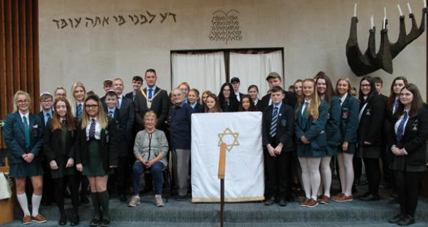 Tomi Reichental and Susan Pollack MBE with Lord Mayor John Finucane and local school pupils at the synagogue in Belfast in October 2019.