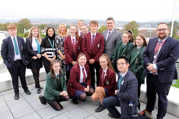 Safet Vukalić with teachers and pupils from St Cecilia's College, St Patrick's and St Brigid's College, and Foyle College at the public event in Derry/Londonderry.