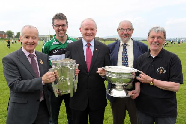 Pictured with the deputy First Minister are (l-r)  Michael Hasson, Ulster GAA Chairman, Feargal McNicholl, Na Magha Club Chairman, deputy First Minister, Brian Smith, County Derry GAA Chairman & Sean Mellon, founding member.