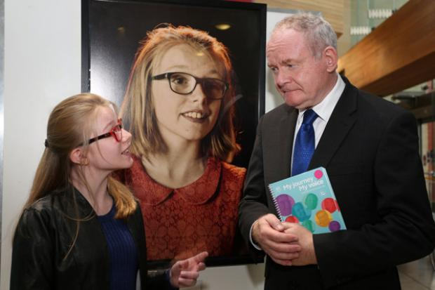 Molly Bradley pictured talking to the deputy First Minister Martin McGuinness about her experience of taking part in the My Journey My Voice exhibition.