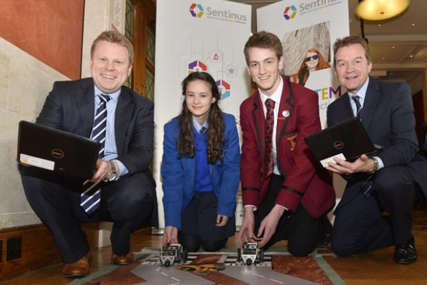 Junior Minister Alastair Ross pictured with Maeve Stillman from St Mary's College in Londonderry, Daniel Stewart from Ballyclare High school and Peter Morris, Head of Operations, BT in Northern Ireland.