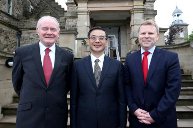 The deputy First Minister, Martin McGuinness, and Junior Minister, Alastair Ross pictured with HE Mr Zhou Qiang, Chief Justice and President of the Supreme People's Court of China