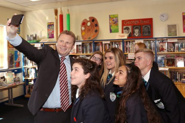 Junior Minister, Alastair Ross gets a quick selfie with some of the pupils rom Malone Integrated College during his visit.