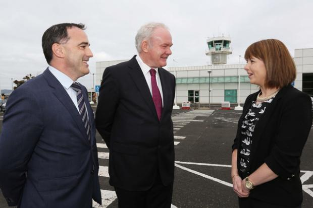 The deputy First Minister, Martin McGuinness speaking the Paul Byrne, Board member, City of Derry Airport, and Frances Wilson, Company Secretary, City of Derry  Airport.
