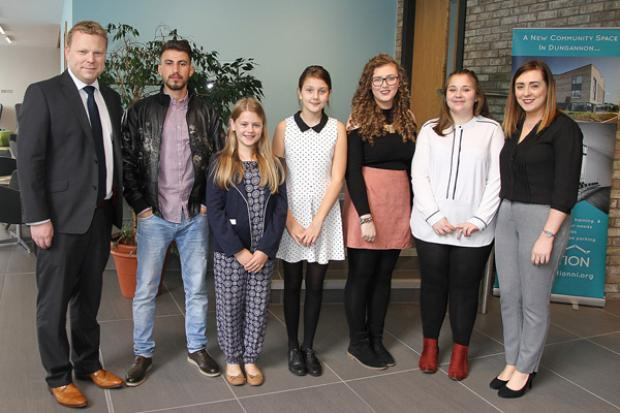 Junior Ministers Alastair Ross and Megan Fearon pictured with young people participating in the T:BUC Engagement Forum in Dungannon