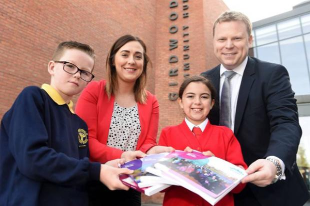 Junior Ministers pictured with pupils outside Girdwood Community Hub