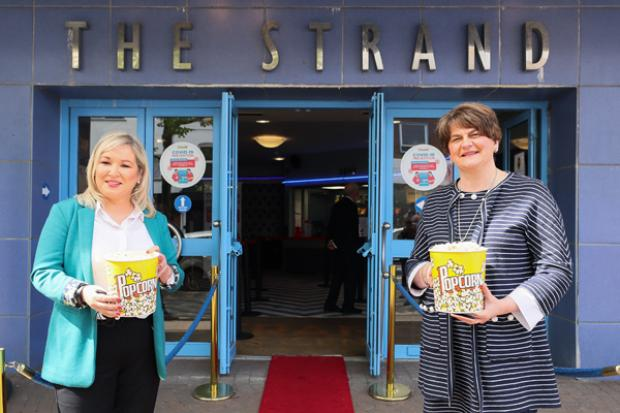 First Minister Arlene Foster and deputy First Minister Michelle O'Neill visited the Strand Arts Centre in Belfast to mark the reopening of indoor arts and hospitality venues.
