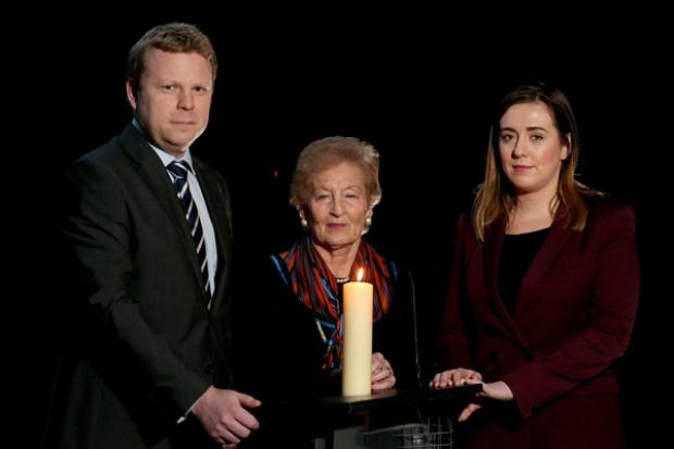 Junior Ministers Megan Fearon and Alastair Ross along with Holocaust survivor Ms Mindu Hornick  at an event to commemorate Holocaust Memorial Day.