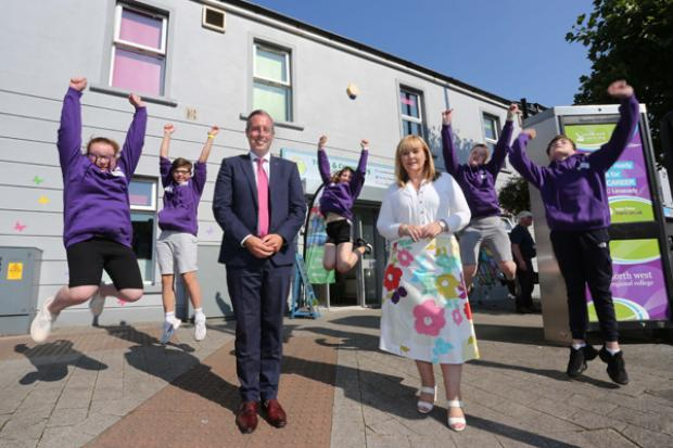 First Minister Paul Givan and Education Minister Michelle McIlveen join young people who took part in a Together: Building a United Community Camp delivered by Roe Valley Residents Association.