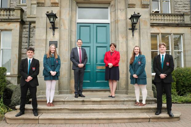 First Minister Arlene Foster with Principal Robin McLoughlin and pupils from Banbridge Academy during a visit to the school.
