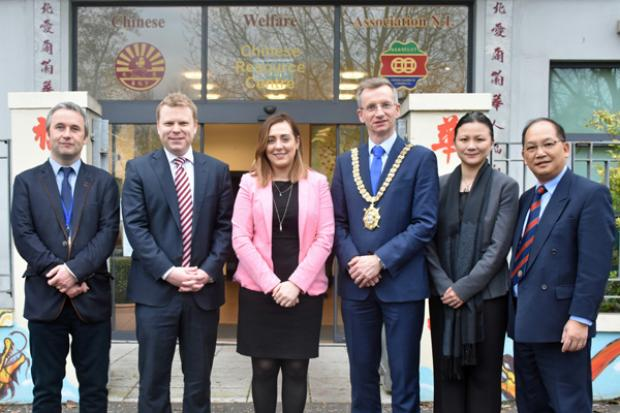 Junior Ministers Alastair Ross and Megan Fearon outside the Chinese Welfare Association headquaters in Belfast