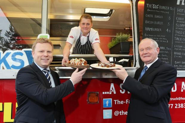 The deputy First Minister, Martin McGuinness and Junior Minister, Alistair Ross pictured with Peter Callan who started his Fat Truck initiative with the support of the Executive funded Social Investment Project through West Belfast Works