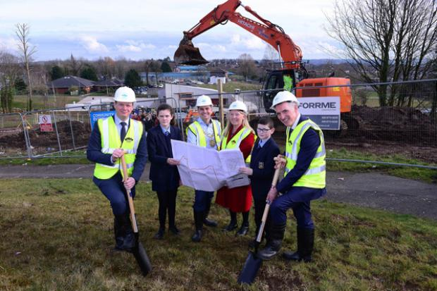 Junior Ministers Gordon Lyons (left) and Declan Kearney (right) with Lord Mayor Daniel Baker, St Colm's High School pupils Clodagh McCann and Ryan Flannery and Annie Armstrong of Colin Neighbourhood Partnership at the sod cutting ceremony.