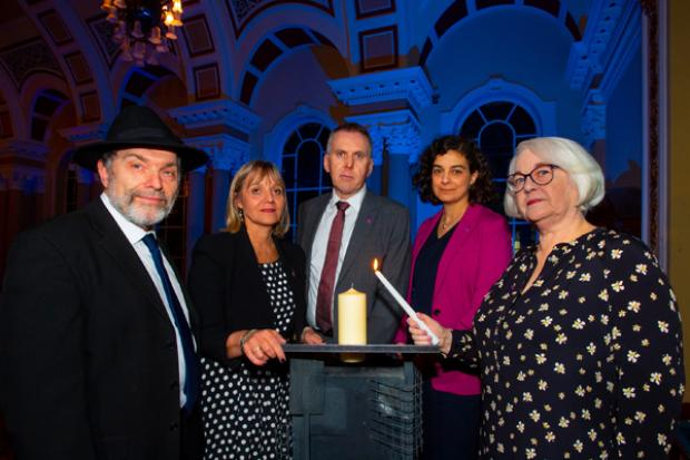 Pictured L-R , Rev David Kale (rep from the Jewish community) Laura Marks, Chair of the HMDT, Head of the Northern Civil Service, David Sterling, Olivia Marks-Woldman, CEO HMDT, with Holocaust survivor Joan Salter MBE, at the Holocaust memorial event