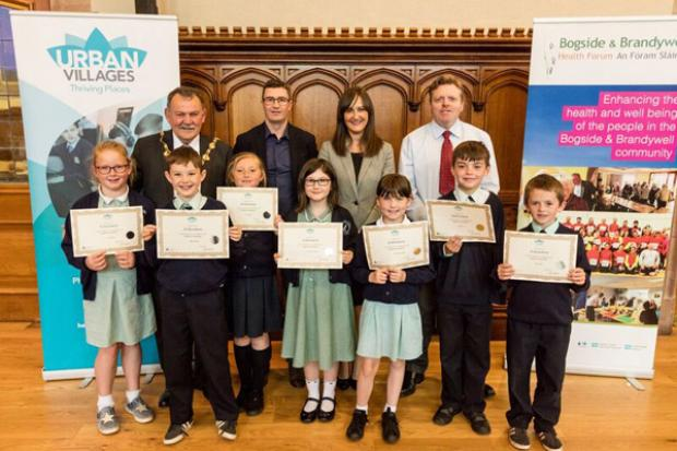 L-R (back row): Maolíosa McHugh, Mayor of Derry and Strabane District Council, Seamus Ward, BBHF, Linsey Farrell, Programme Director, Urban Villages Initiative, Mr Gabriel Kelly, and children from Longtower PS.