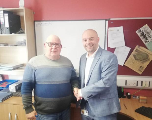 Pictured (L-R) Ronnie Black, Ardoyne Community Partnership and Gavin King, TEO.