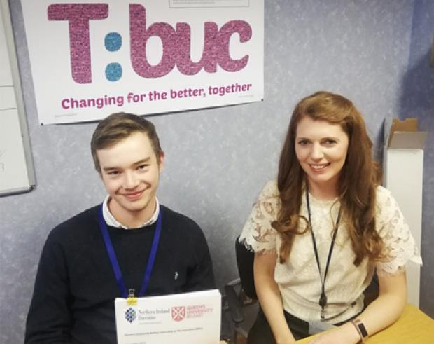 Pictured (L-R) Kye Revington with one the reports he produced, and Anne McDowell, his line manager during his time in TEO.