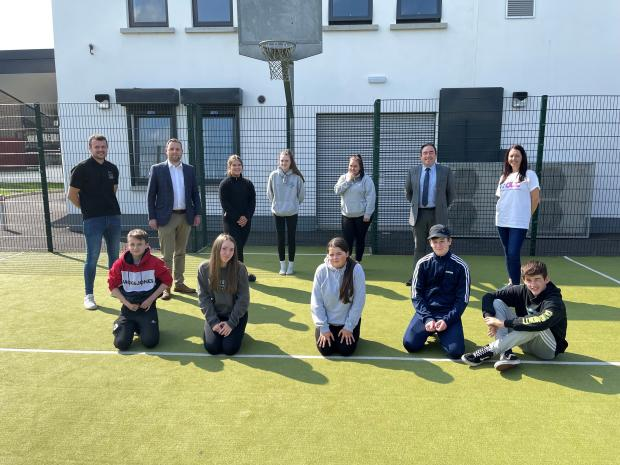unior Minister Gary Middleton pictured with youth worker, Adam Taylor; Michael Hogg, Education Authority; and young people who took part in the Planned Interventions Projects.